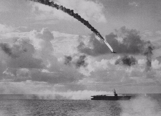A Japanese plane, shot down by antiaircraft fire, plunges to the sea in flames.  What, you think Im using this as a metaphor?  Get a life!