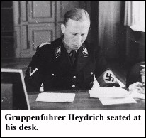 Heydrich seated at his desk