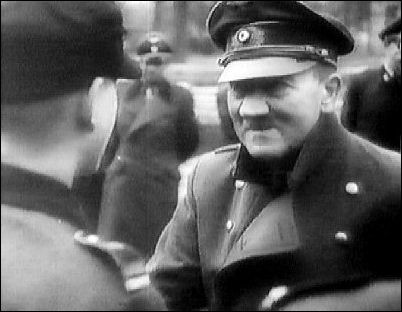 Near the end--April 20th, 1945--the Führer with Hitler Youths outside his Berlin bunker.
