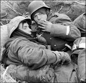 Young replacements huddle in a foxhole on the Russian Front in early 1942--now out of the Hitler Youth and in the German Army--and soon to face the ferocious Red Army.