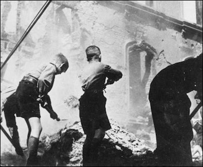 On the German home front, HJ boys clean up the rubble after yet another air-raid.
