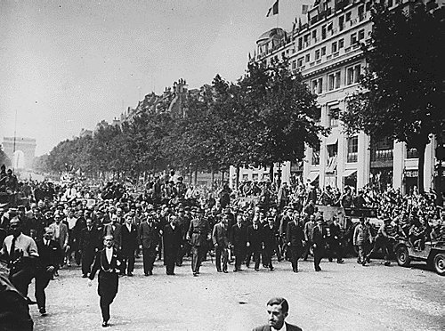 German pows are led through the streets of paris. below: general de